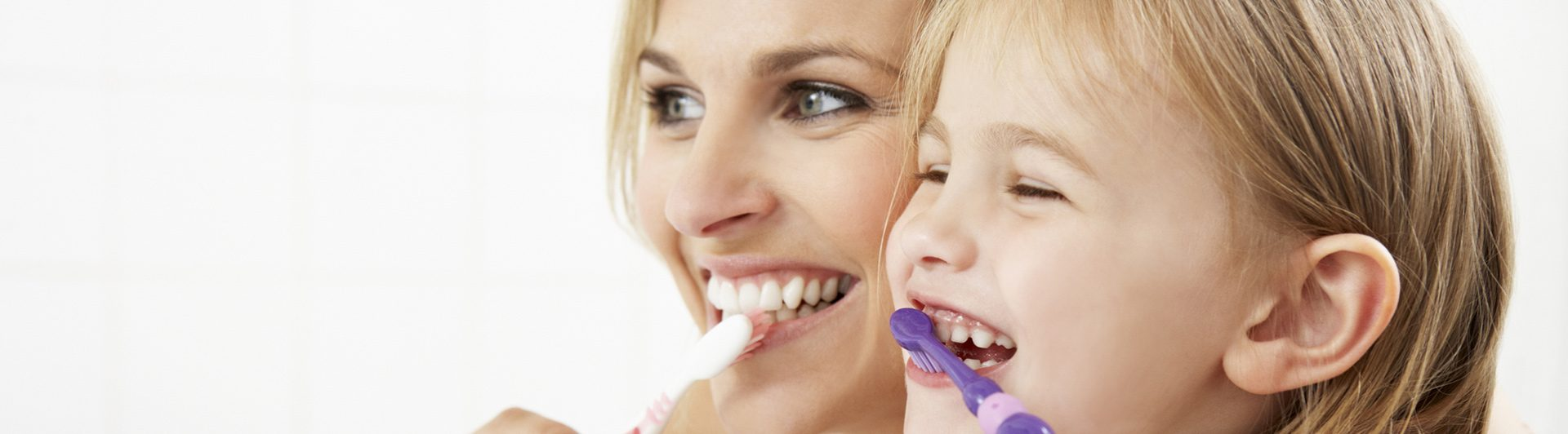 Mother and Daughter Brushing their Teeth Together