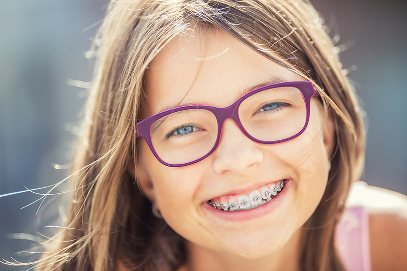 Youn Smiling Girl with Braces